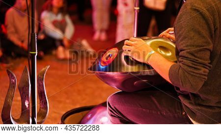 Close Up Of Male Hands Playing Handpan Musical Instrument, Hand Drum At Ethnic Music Concert. Relaxa