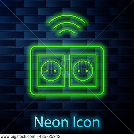 Glowing Neon Line Smart Electrical Outlet System Icon Isolated On Brick Wall Background. Power Socke