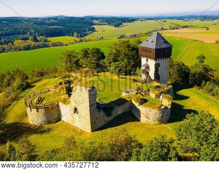 Hartenstejn is gothic castle from the 15th century. Aerial view to famous landmark in Western Bohemia, Czech Republic, Central Europe.
