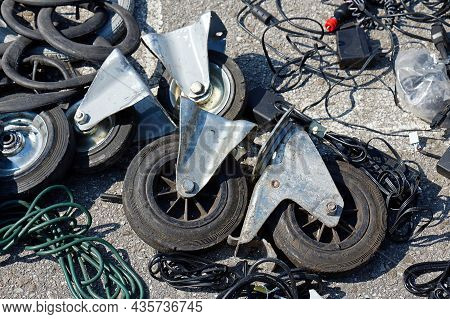 Mess Of Caster Wheels And Other Transportation Industry Equipment On Dirty Floor