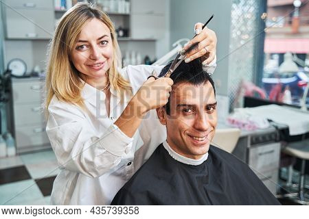 Process Of Cutting Off Strand Of Hair From Visitor Head