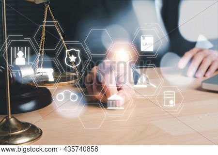 Male Lawyer Hand Touching Holographic Law Icon On Office Desk, Terrorism, Crime, Judgment, Verdict,