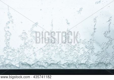 The Beauty Of Nature, The Freeform Shape Of Transparent Crystal Frosty Ice Cover Outside The Glass W