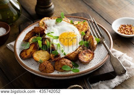 Rustic Roasted Potatoes With Fried Egg For Breakfast