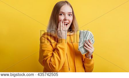 Happy Excited Rich Young Woman Win Money Cash. Lady Hold Dollar Stack Surprised Rejoices At Lottery