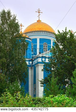 Achinsk, Siberia, Russia -09.01.2021: Blue Orthodox Church Under Golden Domes In Classical Style