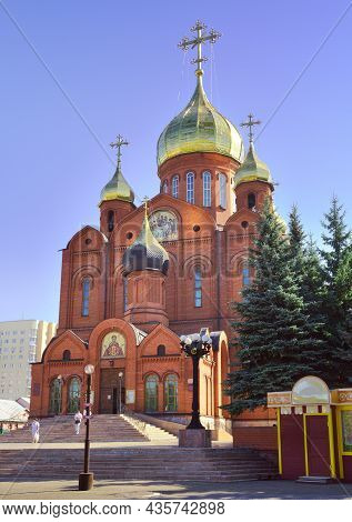 Kemerovo, Siberia, Russia-09.01.2021: Brick Cathedral Orthodox Church With Crosses Under A Blue Sky.