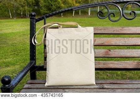 Rustic Tote Bag On The Steel Patio Bench Mockup