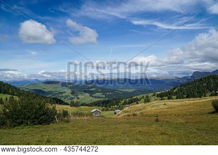 Idyllic And Calm Alp Scenery: The Worldfamous Alp De Siusi In The Dolomites. Green Meadow And A Blue