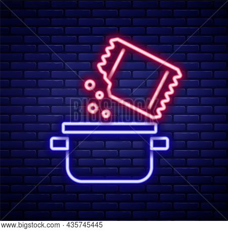 Glowing Neon Line Cooking Pot And Icon Isolated On Brick Wall Background. Boil Or Stew Food Symbol.
