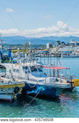Uljin-eup, South Korea; September 19, 2021: Fishing Trawlers Docked In Calm Water At Hupo Seaport.