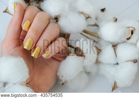 Manicured Female Hands With Stylish Golden Nails. Trendy Modern Design Manicure. Gel Nails. Skin Car