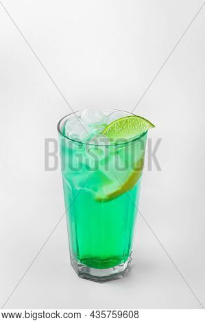 Beautiful Transparent Glass Of Summer Drink. Green Lemonade With Ice And Lime Isolated On A White Ba