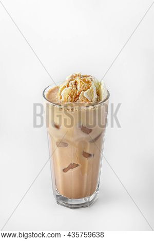 Beautiful Transparent Glass Of Summer Drink. Coffee With Ice Cream And Ice Cubes Isolated On A White