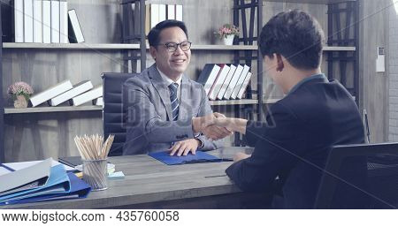 Two Businessman Signing Contract Document Start Business Agreement Dealing Teamwork. Close Up Hand Y