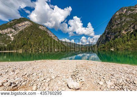Lago Di Braies Or Pragser Wildsee, Alpine Lake And The Mountain Range Of Sasso Del Signore, Dolomite