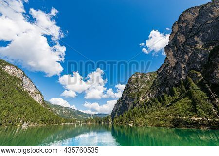 Pragser Wildsee Or Lago Di Braies. Alpine Lake And The Mountain Peaks Of The Small And Great Apostle
