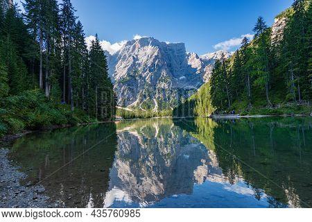 Lake Braies (lago Di Braies Or Pragser Wildsee) And The Mountain Peak Of Croda Del Becco Or Seekofel