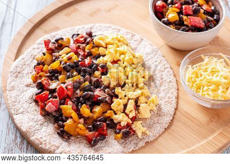 Healthy High Protein Burritos With Eggs, Bell Peppers, Sweet Potato, Black Beans On Whole Wheat Tort