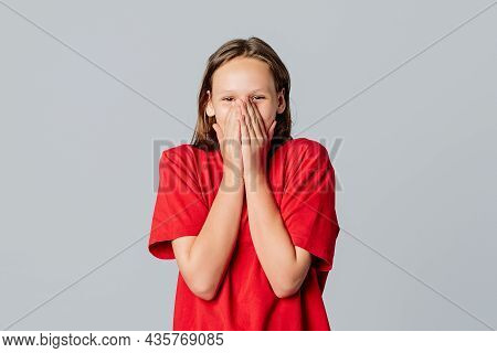 Oh My Gosh. Portrait Of Surprised Cute Brunette Teen Girl Gasping In Awe, React Shocked, Covering Mo