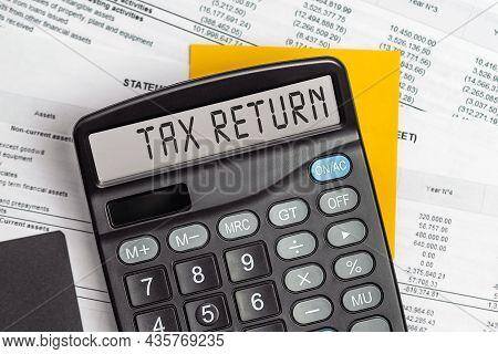Tax Return. On Display Of Calculator Is Written Tax Return