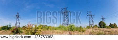 Several Steel Lattice Anchor Transmission Towers Of Overhead Power Lines At The Places Of Transmissi