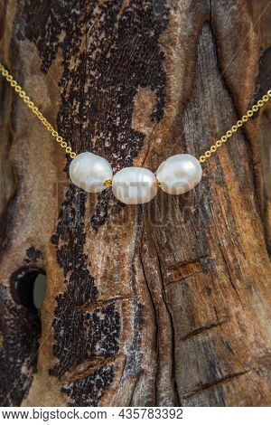 Jewelry Fashion Photography. Pearl Necklace Fashion Photography. Pearl Necklace Presented On Old Woo