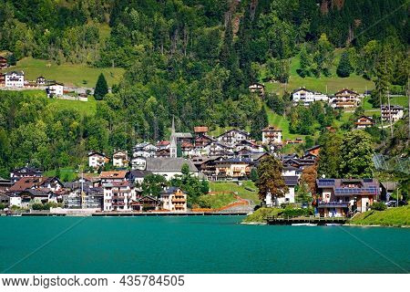 Amazing alpine scenery, Dolomites mountains. Beautiful lake lago di Alleghe, northern Italy (Belluno province), Europe