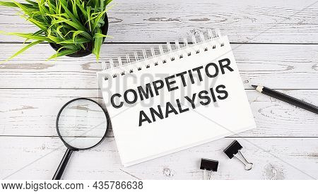 Competitor Analysis Text Concept Write On Notebook With Office Tools On The Wooden Background