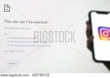Tashkent, Uzbekistan - 6 October 2021: Hand Holds Mobile Phone With Instagram Logo And Computer Moni