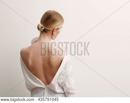 Minimalist Photo, Fashionable Girl In Stylish Summer Things - White Shirt. View From The Back. Earri