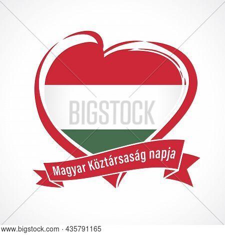 Magyar Koztarsasag Napja - Text On Ribbon Hungarian Republic Day. Hungary Flag In Heart Shape For Ma