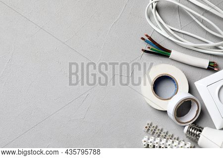 Set Of Electrician's Accessories On Grey Background, Flat Lay. Space For Text
