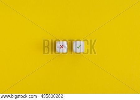 Cross And Check Mark On A White Cubes On Yellow Background. Approving, Voting Or Right Decision Conc