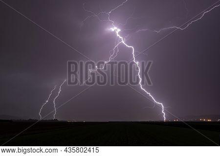 Lightning Strike At Dark Stormy And Rainy Night