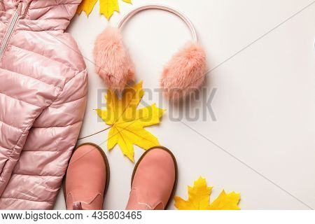 A Set Of Warm Autumn-winter Clothes On A White Background. Jacket Boots Headphones. Flat Lay Top Vie