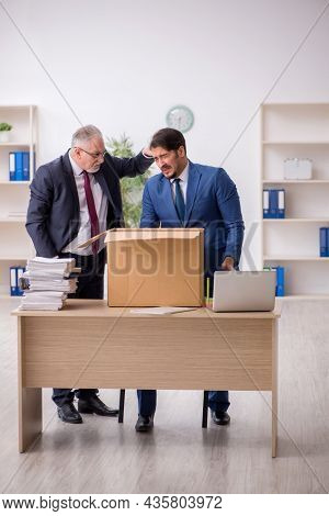 Two male employees in dismissal concept