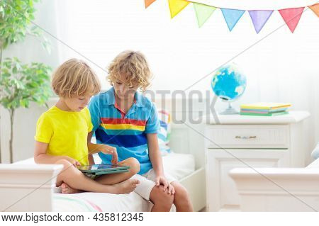 Child With Tablet Computer. Kids Study Online.