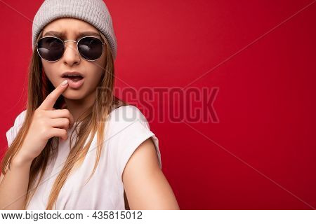 Closeup Of Young Emotional Funny Thoughtful Beautiful Attractive Cute Dark Blonde Woman With Sincere