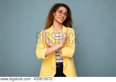 Photo Of Young Emotional Attractive Brunette Curly Woman With Sincere Emotions Wearing Stylish Yello