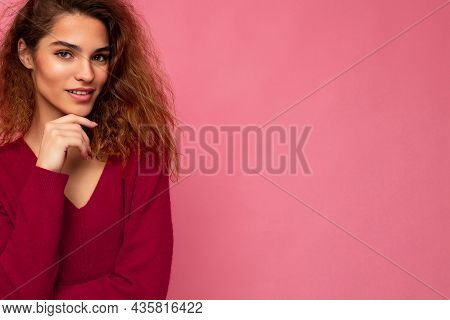 Portrait Of Young Positive Thoughtful Beautiful Brunette Curly Woman With Sincere Emotions Wearing T