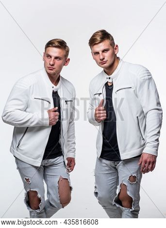 Guys Wear Casual Outfit. Young Confident Brothers. Confident Fashion Models. Twins Brother In White