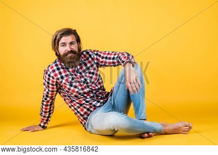 Guy With Long Lush Beard And Mustache On Face. Handsome Confident Man Has Perfect Hairstyle. Happy B