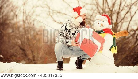 Man Made Snowman. Man Santa Hat Having Fun Outdoors. Guy Happy Face Snowy Nature Background. Hipster