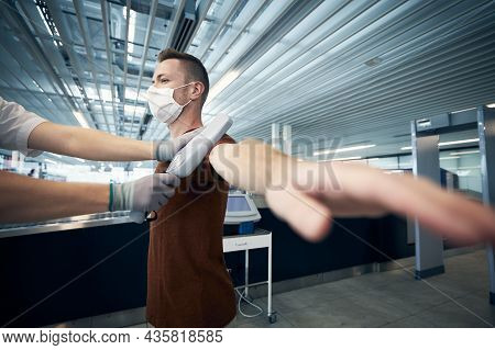 Airport Security Check. Portrait Of Passengers Passing Through Control.