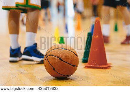 Children Practicing Basketball On School Court. Basketball Training Game Background. Basketball And