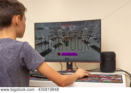 Vilnius, Lithuania - October 09, 2021: Teenager Playing Video Game Squid Game On Computer At Home. S