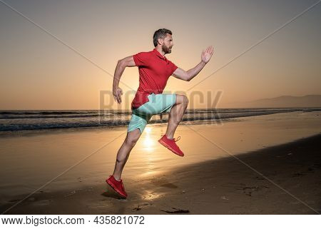 Endurance And Stamina. Young Sprinter. Sport Athlete Run Fast To Win In Sea Sunset.
