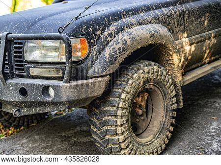 Close-up Of A Wheel Of A Dirty Suv.