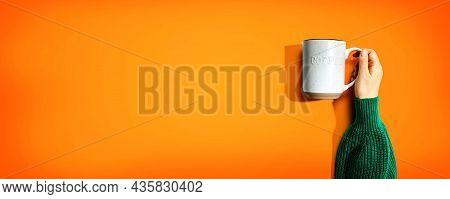 Female Hand Holding A Mug Overhead View - Flat Lay